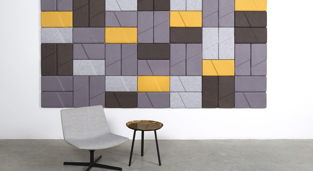 Installation featuring acoustic tile Ecoustic Domino Pewter Taupe Light Grey Yellow sound absorbing felt textile chair stool table wall