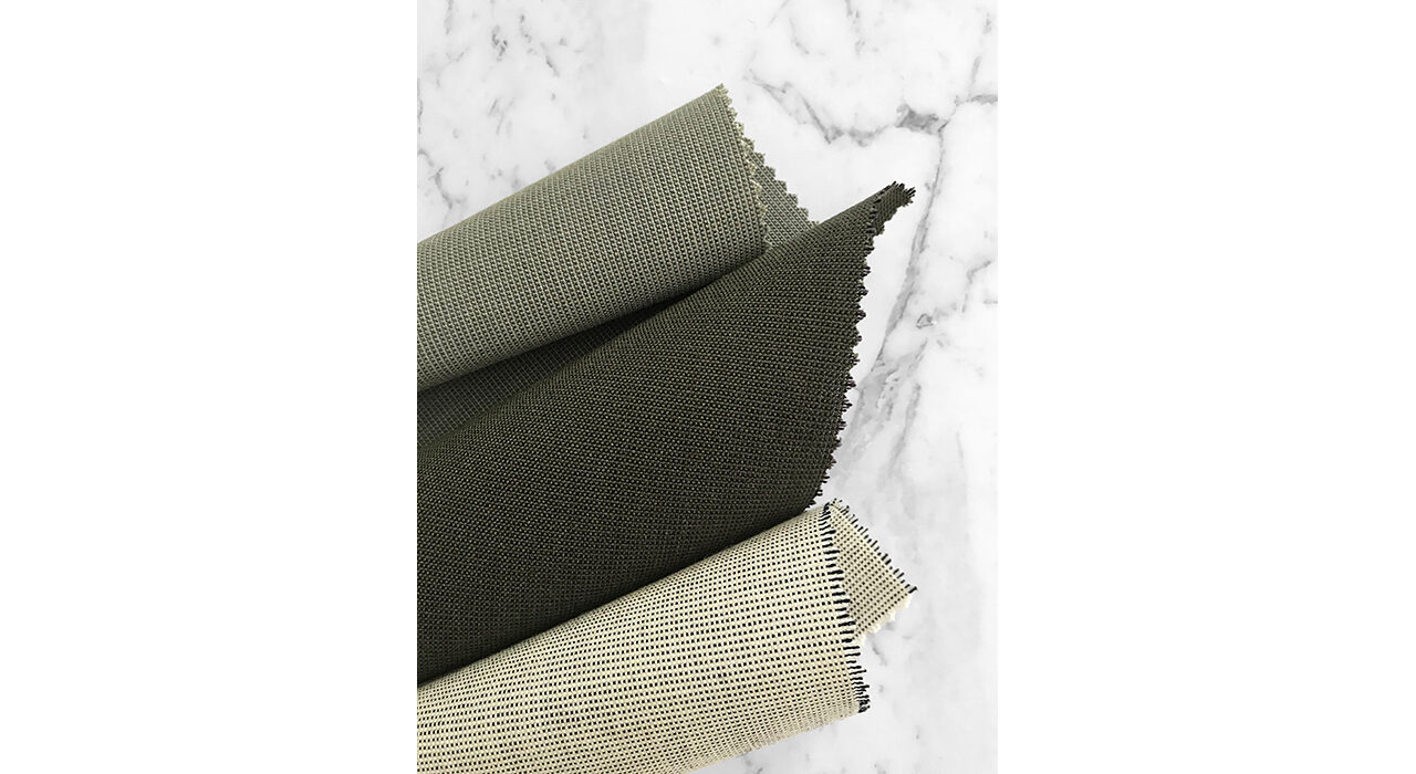 neutral textiles rolled on marble