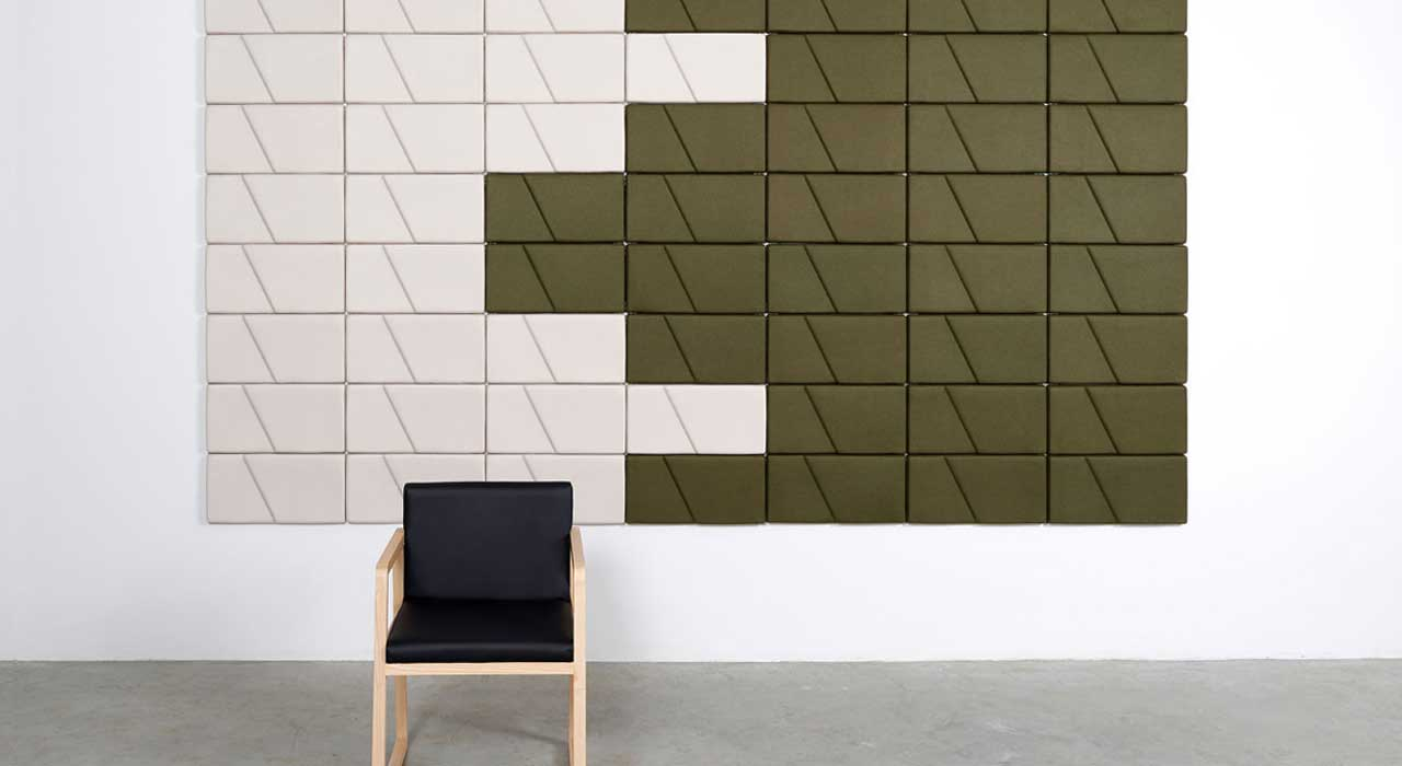 Installation featuring acoustic tile Ecoustic Domino Caper Cream sound absorbing felt textile wall chair