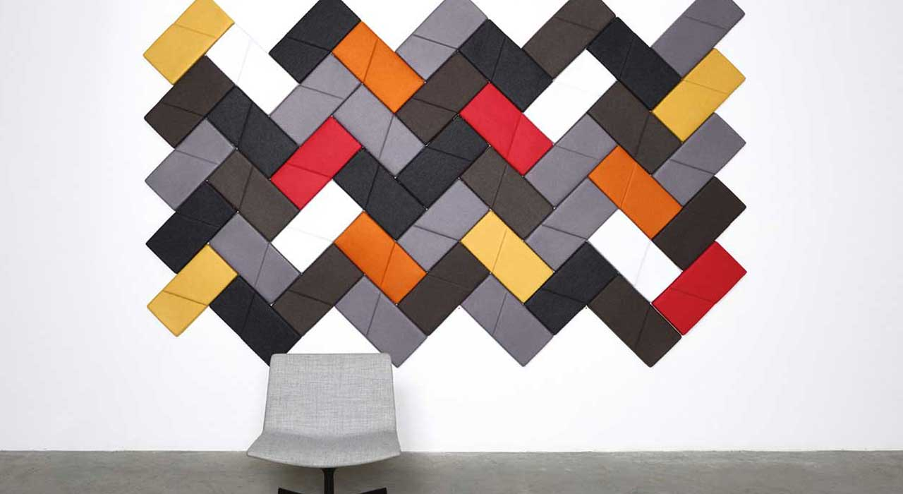 Installation featuring acoustic Ecoustic Domino Red Yellow Orange Pewter Taupe White Charcoal tile panel sound absorbing felt textile chair wall
