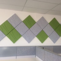 Installation featuring acoustic Ecoustic Drift Light Grey Green tile sound absorbing felt textile office wall