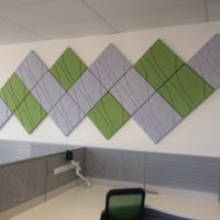 Installation featuring acoustic Ecoustic Drift Light Grey Green tile sound absorbing felt textile office wall desk chair