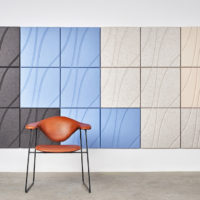Installation featuring acoustic Ecoustic Drift Taupe Sky Natural Cream tile sound absorbing felt textile wall panel chair