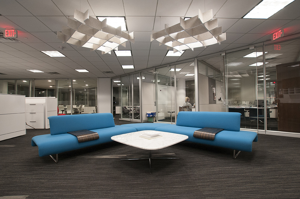 Installation of acoustic baffle Ecoustic Arbor natural felt ceiling office workspace table chairs sound absorbing