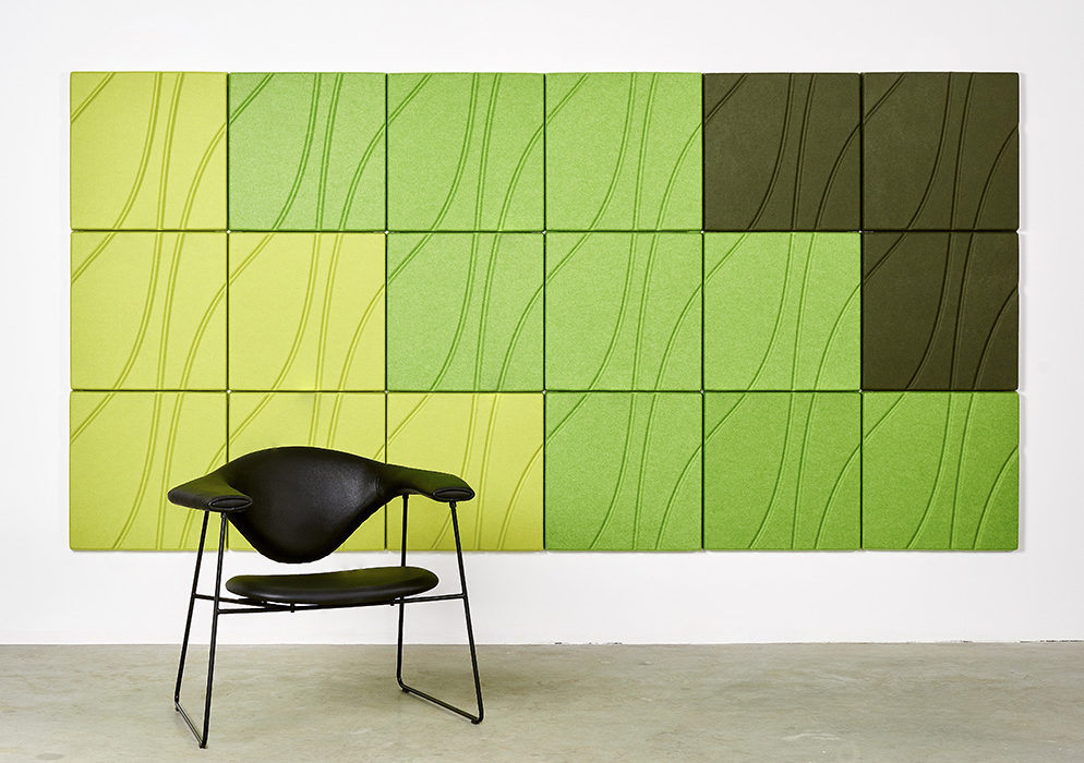 Installation featuring acoustic Ecoustic Drift Green Lime Caper angular set up tile sound absorbing felt textile wall panel chair