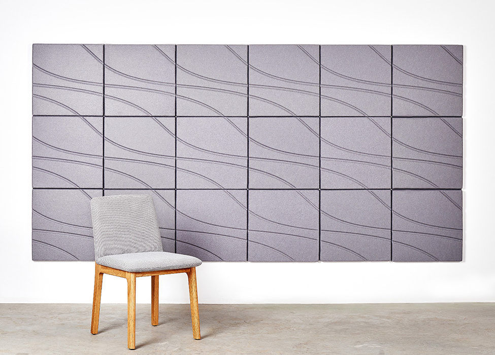Installation featuring acoustic Ecoustic Drift tile sound absorbing felt textile solid pewter set up wall panel chair