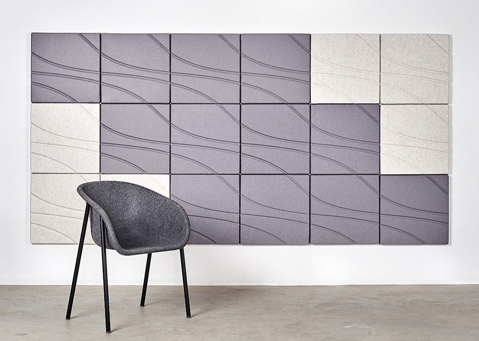 Installation featuring acoustic Ecoustic Drift tile sound absorbing felt textile various color wall panel chair angular arrangement