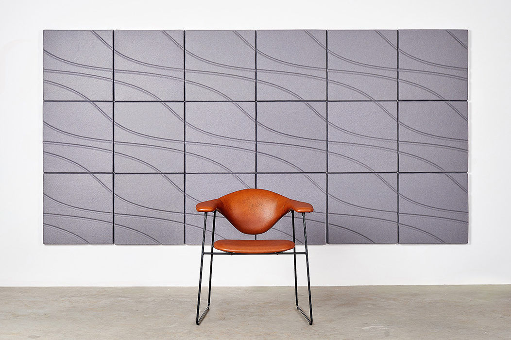 Installation featuring acoustic Ecoustic Drift tile sound absorbing felt textile various color wall panel chair