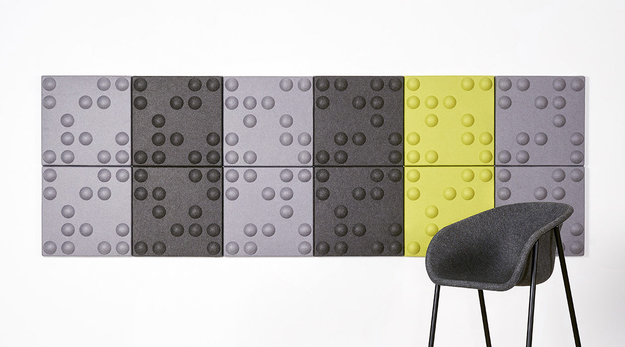 Installation featuring acoustic tile Ecoustic Bond Pewter Charcoal Lime tiles panels sound absorbing felt textile wall display chair