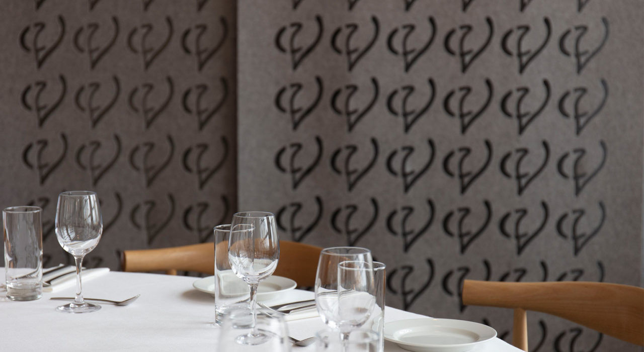 screentrak single screen hanging in restaurant with detail cutout pattern