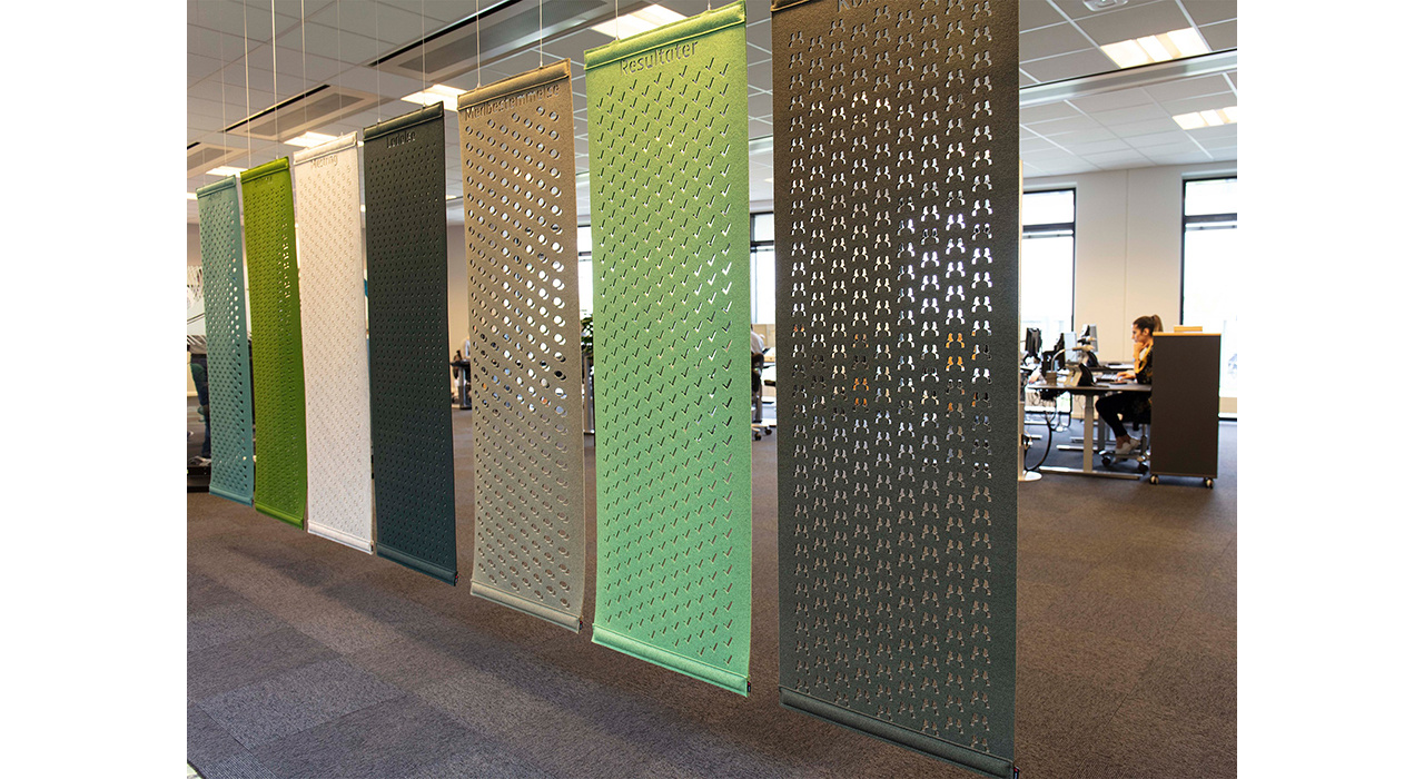 row of multicolored felt screens hanging in office