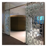 ScreenTrak Bass Web acoustic hanging screen on glass doors