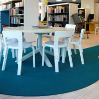custom cut fraster felt rug in library under children's table and chairs