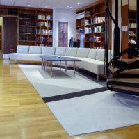 fraster felt rug in library under table and sofa
