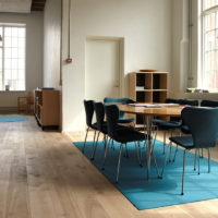 quiet space with table and seating fraster felt rug underneath