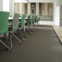 conference table and chairs with felt rug underneath