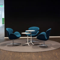 brown circular felt rug with seating in high traffic area