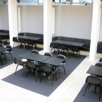 cafeteria setting with many chairs and tables fraster felt rug underneath