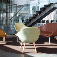 brown circular felt rug in lobby area with chairs