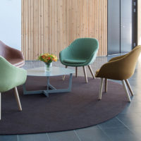 brown circular felt rug under chairs in lobby