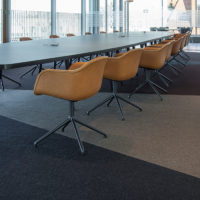 conference room with long table and chairs fraster felt rug underneath