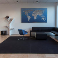 office space with faster felt rug sofa and chair