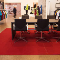 felt rug with table and chairs in clothing store