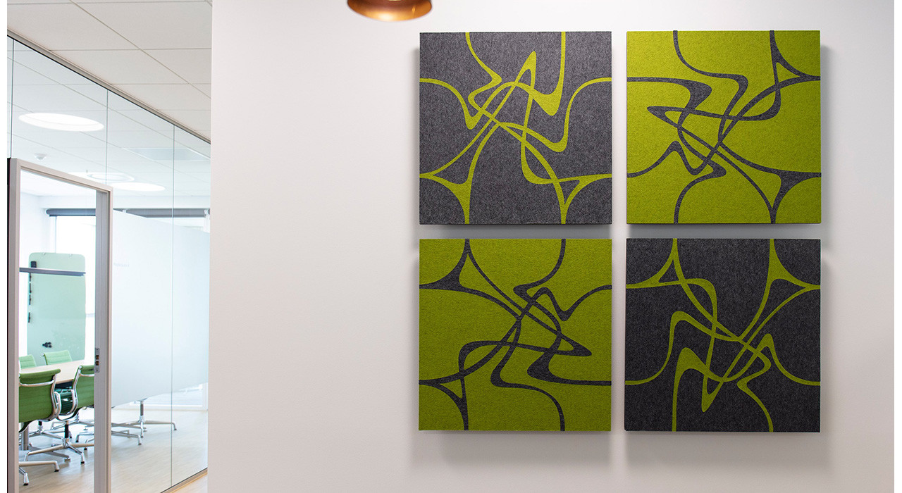 green and charcoal patterned acoustic wall tiles installed on office wall
