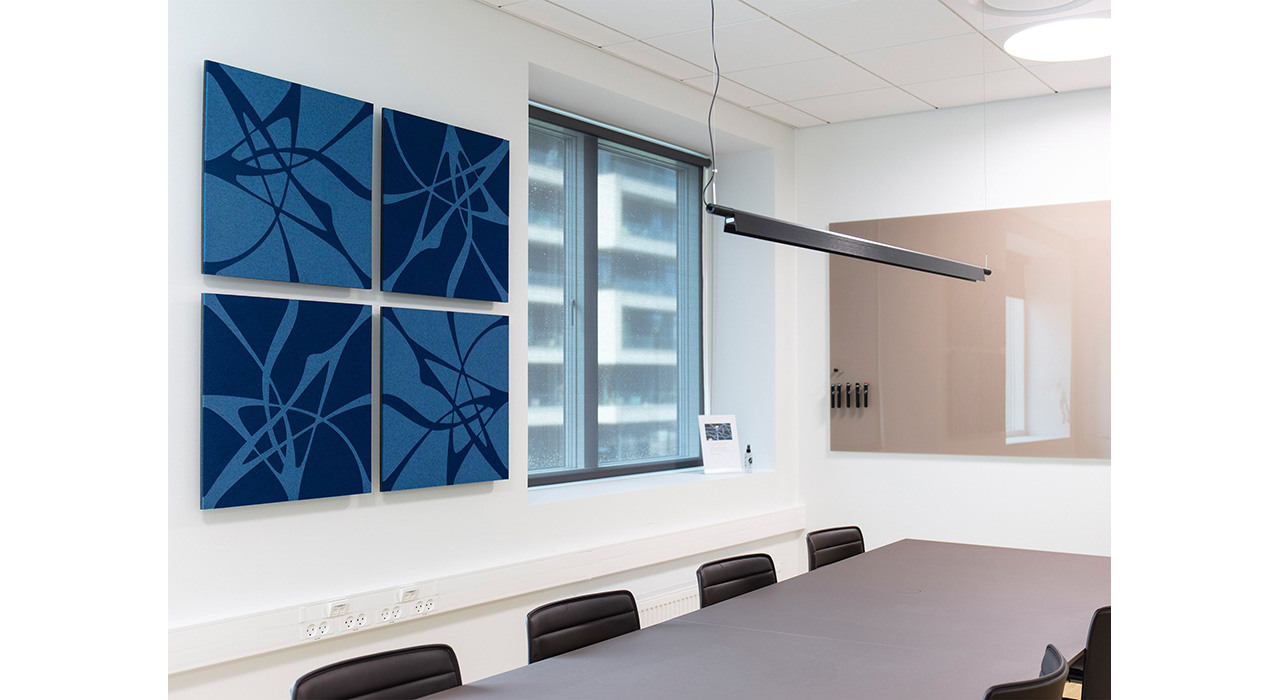 light and dark blue acoustic wall panels installed on office wall behind conference table