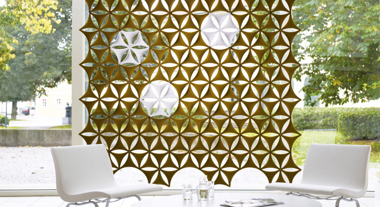 Installation featuring acoustic tile Airflake brown gold green table chairs white sound absorbing