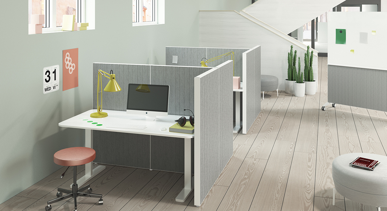 Installation featuring acoustic Alumi Screen office workspace grey plant desk chair table sound absorbing