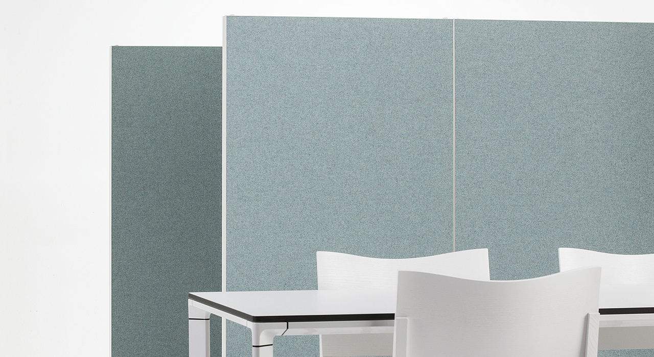Installation featuring acoustic Alumi Screen blue chair desk sound absorbing