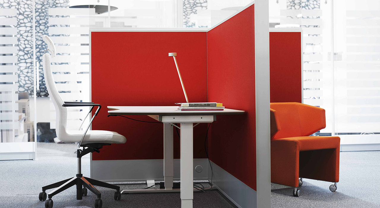 red acoustic floor screen dividing desk areas in office