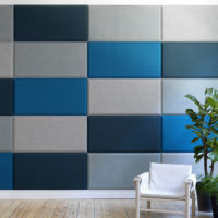 Installation featuring acoustic tile Domo Wall blue grey plant chair sound absorbing wool