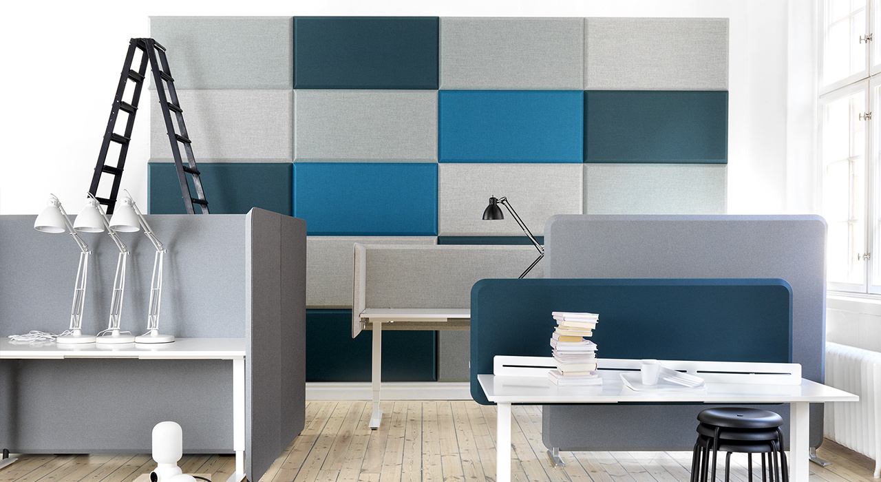 Installation featuring acoustic tile Domo Wall blue grey office work space desk chair table sound absorbing wool