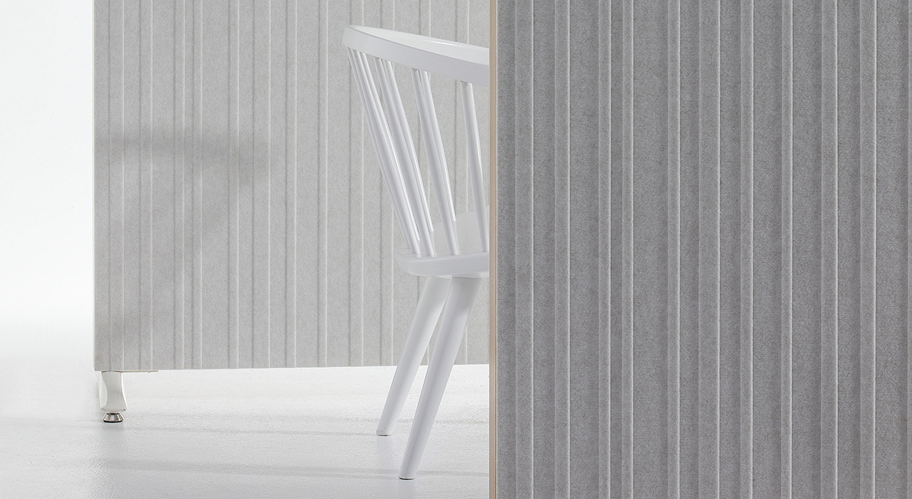 Installation featuring Doremi Screen grey white standing floor screen chair sound absorbing partition close up