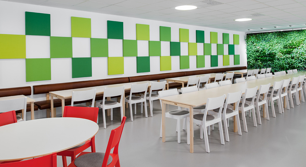 green soneo wall tiles in cafe with seating and tables