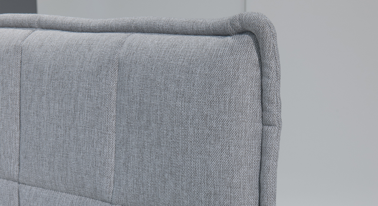 detail of quilted corner on light grey acoustic table screen