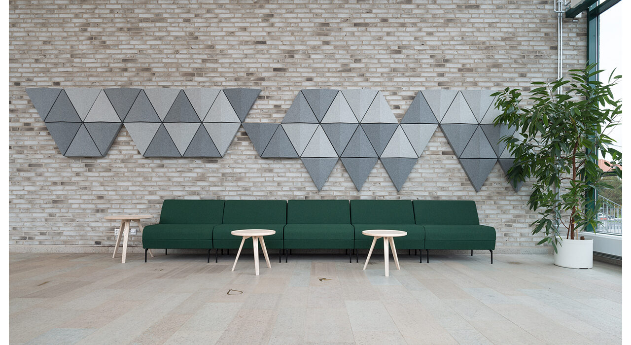 bits light grey acoustic wall tiles on a brick wall