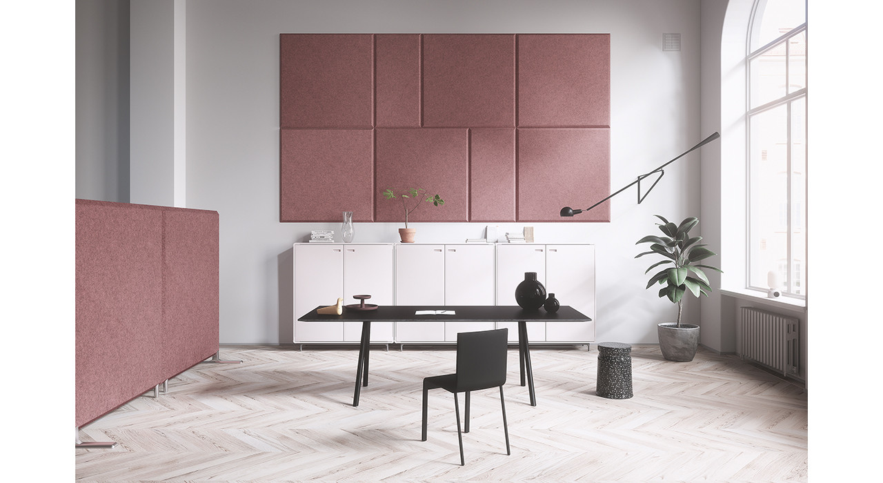 pink sound absorbing wall panels behind desk chair