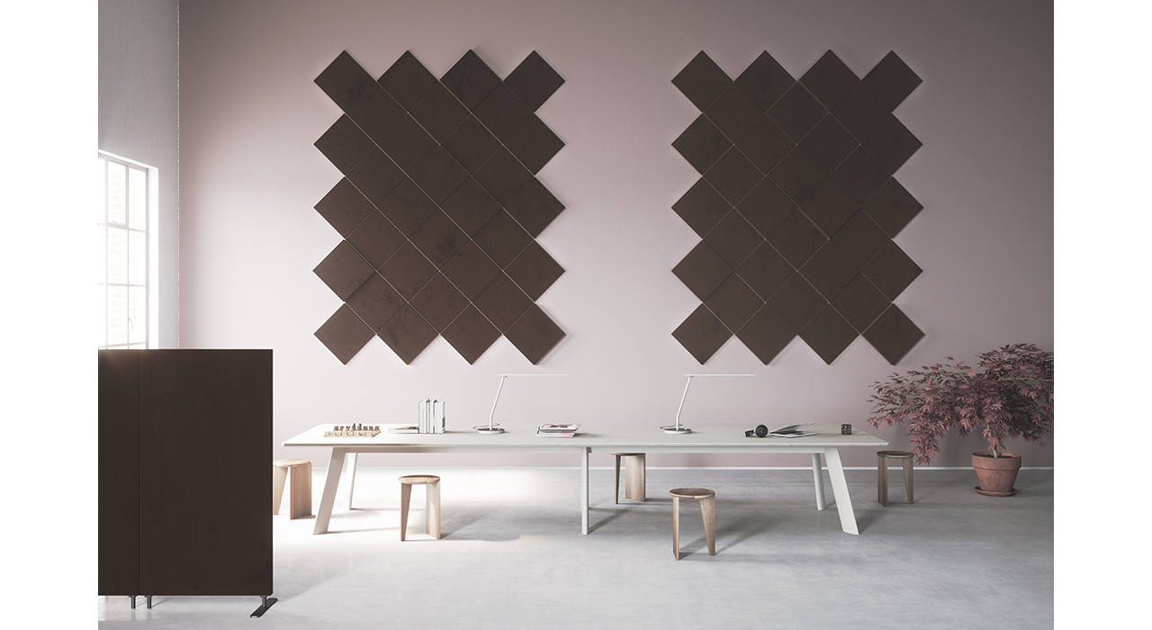 diagonally arranged brown acoustic wall panels in several thicknesses in front of table stools and floor screen