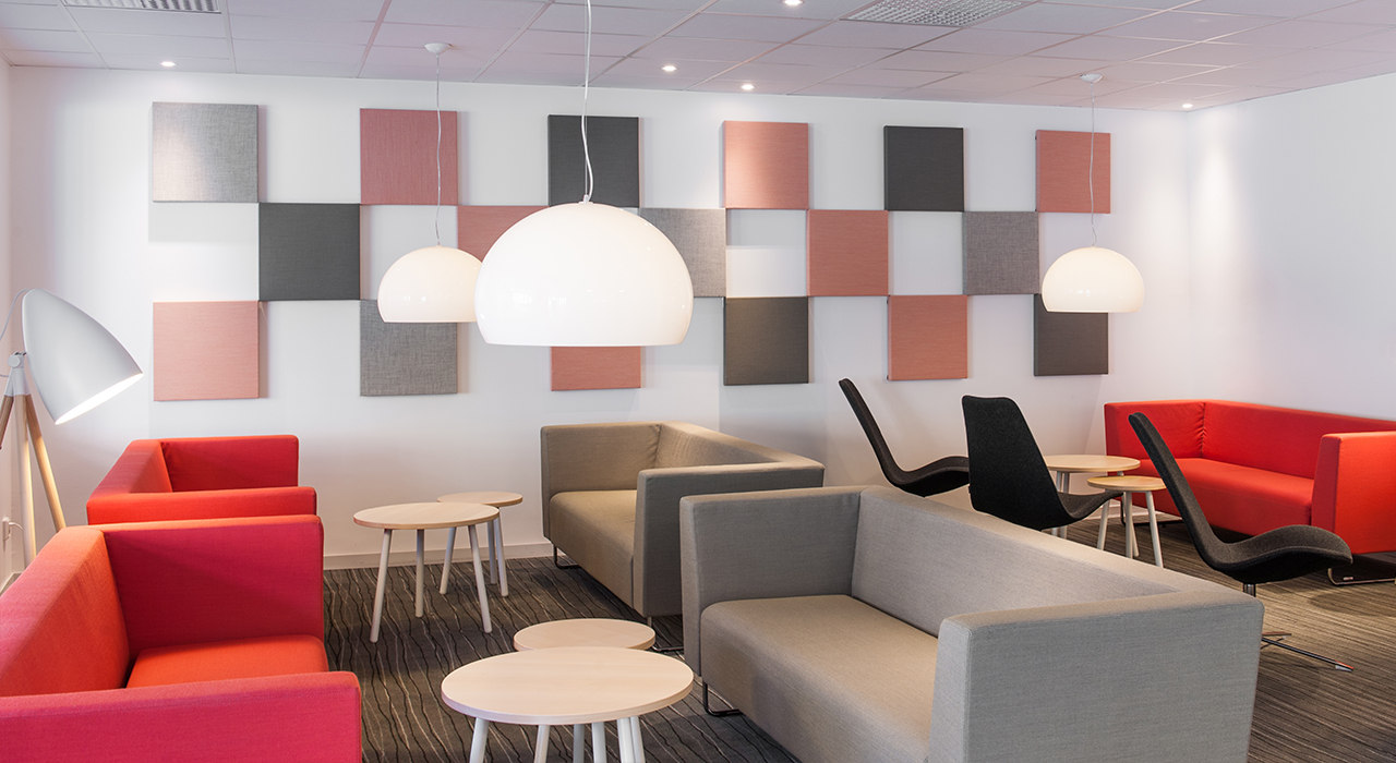 acoustic wall tiles pink and grey in seating area