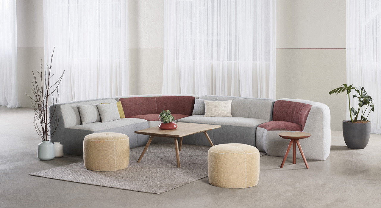 Origin and Feel textiles upholstered on sofa and ottomans