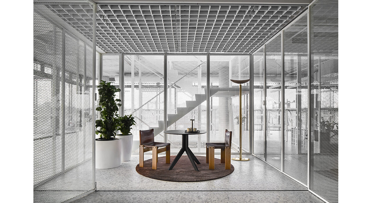 bright open office with sound absorbing grey ceiling tiles