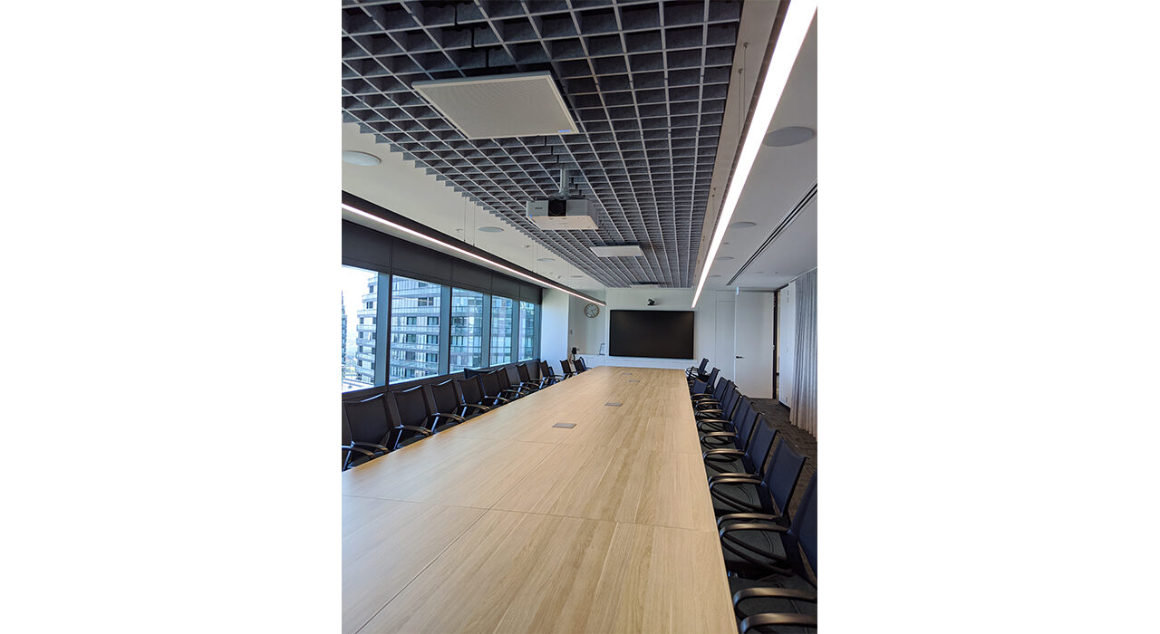 acoustic drop ceiling tiles in a large conference room above table chairs