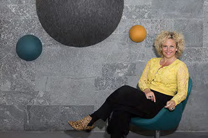 kula acoustic spheres on wall with designer bryndis bolladottir seated