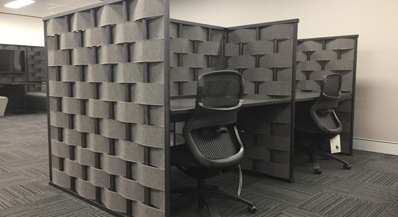Bower screens charcoal felt covering sound absorption installed as cubicle pods with tables and desk chairs