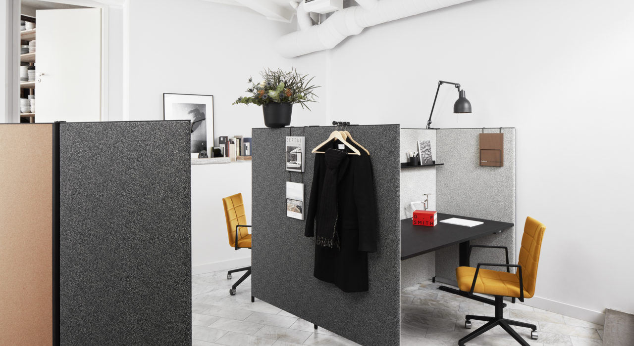 sound absorbing screen acoustic partition dB in charcoal with desk and swivel chair in office