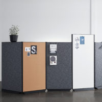 sound absorbing screen acoustic partition dB in charcoal and bronze with writing board and plant in office