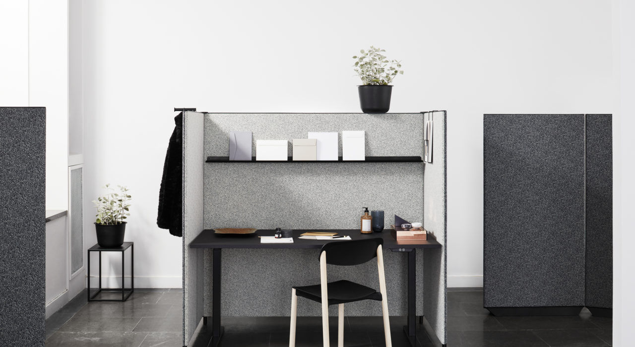 sound absorbing screen acoustic partition dB in grey and charcoal desk and chair with plant in office